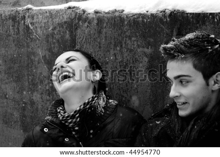 girl laughing and boy in winter - stock photo