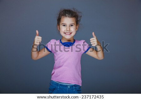 girl laughing and showing sign yes - stock photo