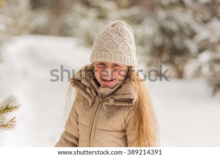 Girl laughing with snow on her nose  - stock photo