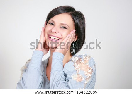 girl laughs a on white background - stock photo