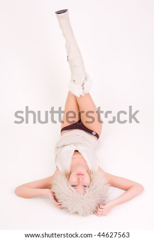 Girl laying on a floor, isolated studio shot