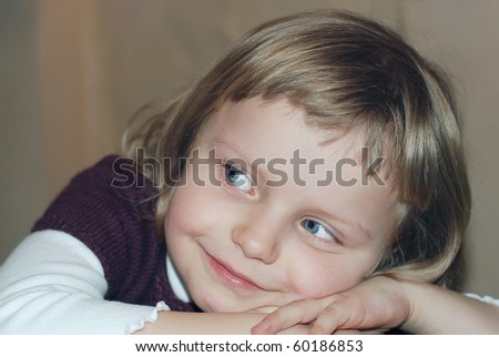 Girl laying on hands and listening concentrated and attentively