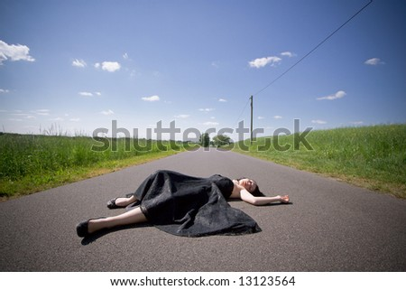girl laying on the street - stock photo