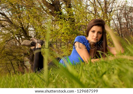girl lays on a grass - stock photo