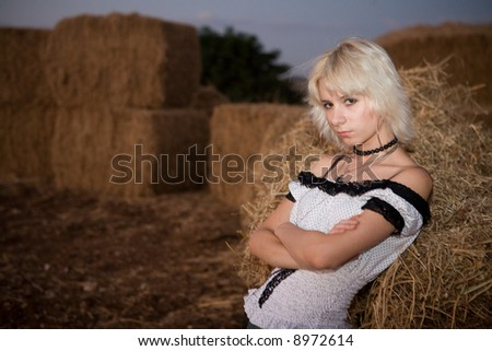 girl leaning on hay