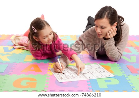 Girl learning handwriting practice from teacher. Isolated on white. - stock photo