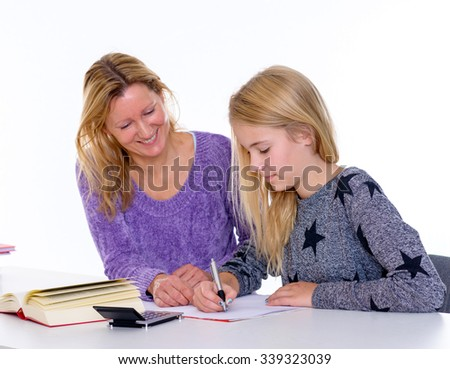 girl learning together with teacher in the classroom - stock photo