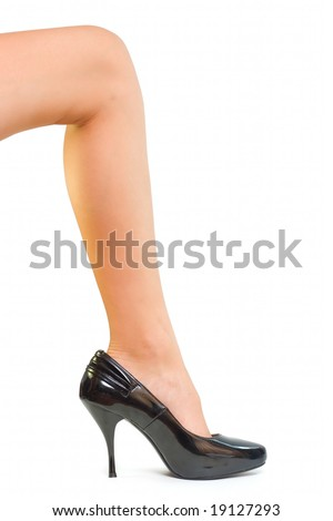 Girl leg on big shoe isolated on white