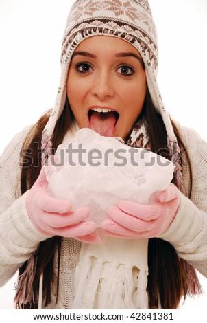 Girl licking giant ice cube on white isolated background - stock photo