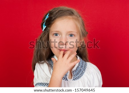 girl licking her fingers - stock photo