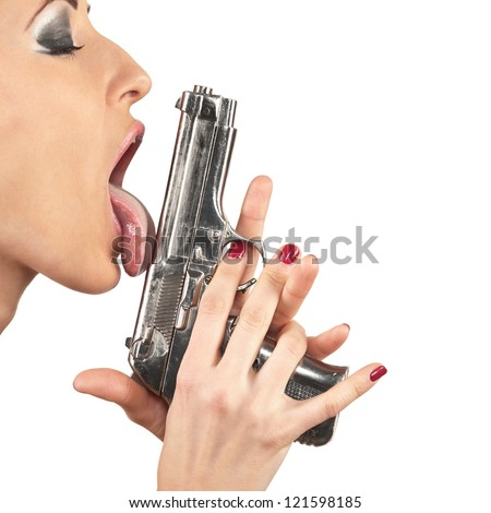 Girl licking tongue gun, isolated on white - stock photo