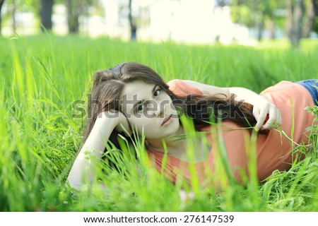 Girl lies on the grass - stock photo
