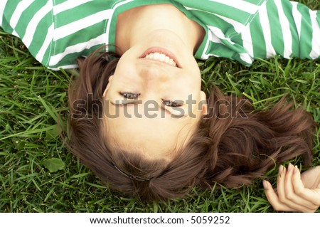 girl lies on the grass