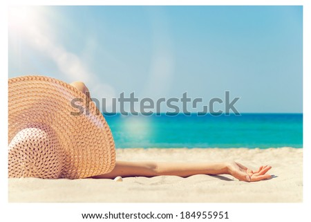 girl lies on the white sand on the beach - stock photo