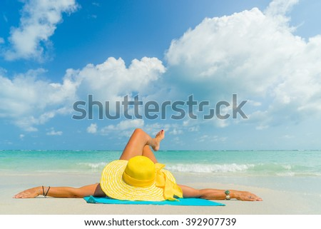 girl lies on the white sand on the tropical  beach - stock photo