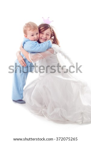 Girl like a little fairy huging a boy, isolated on white