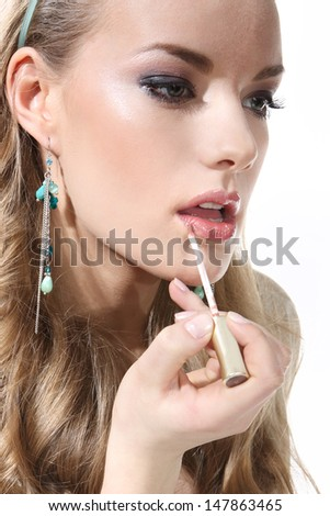 Girl lipstick on a white background - stock photo