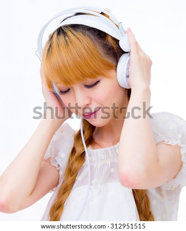 girl listen to music by headset / Asian lady japanese style - stock photo
