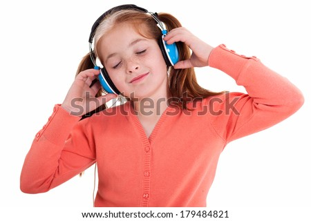 girl listening music and holding the headphones and smile  - stock photo