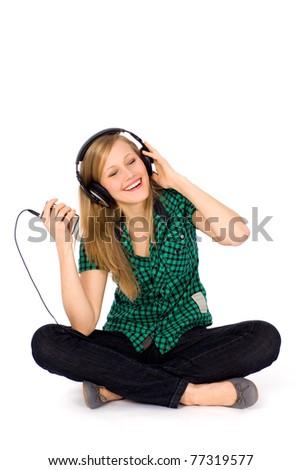 Girl listening to music - stock photo
