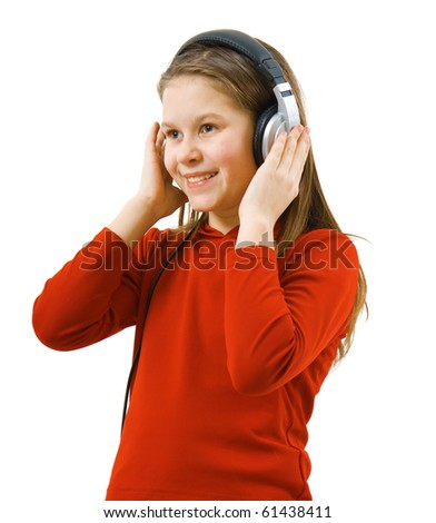 Girl listening to music in big headphones on white background - stock photo