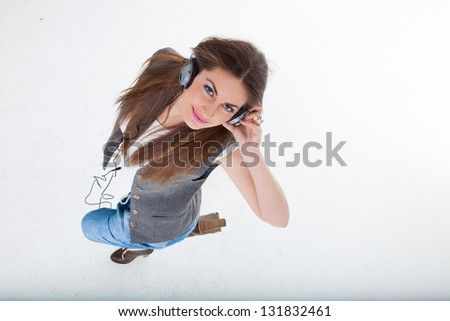 Girl Listening to Music in headphones - stock photo