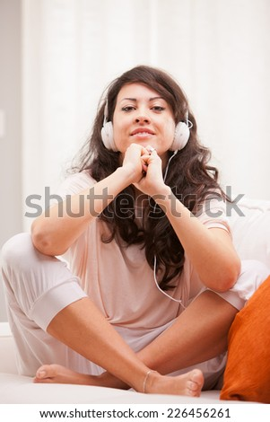 girl listening to music in her house dancing and singing happily in her living room - stock photo