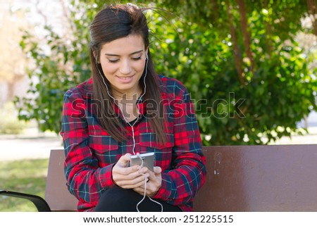 Girl listening to music in the park