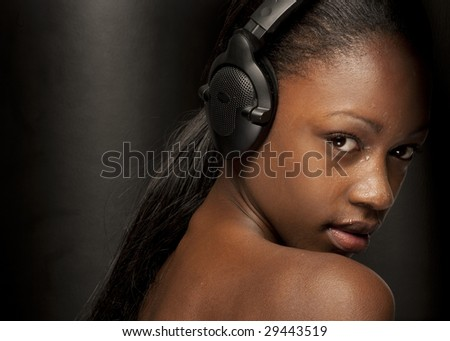 girl listening to music looking happy and sexy - stock photo