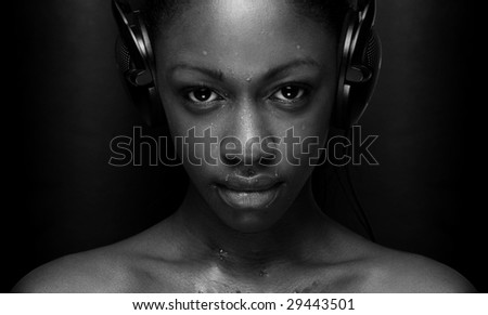 girl listening to music looking happy sexy in black and white - stock photo