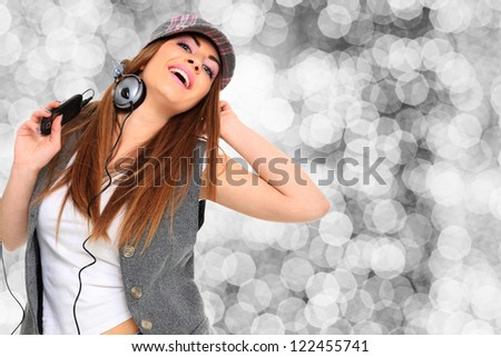 Girl Listening to Music over bokeh background - stock photo