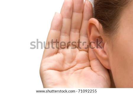 Girl listening with her hand on an ear