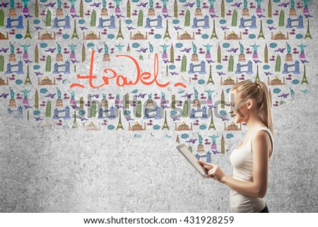 girl looking at new travel on tablet - stock photo
