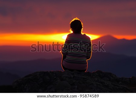 girl looking at sunset - stock photo