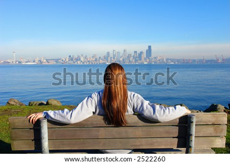 Girl looking at the City of Seattle - stock photo