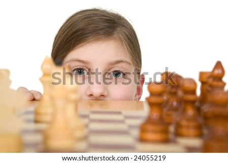Girl looking chess on the white background - stock photo