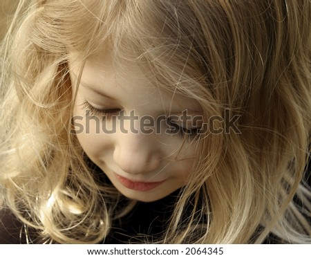 Girl looking down - stock photo