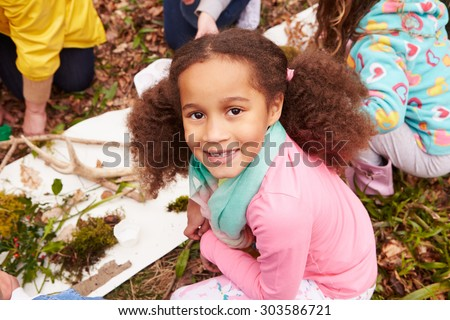 Girl Looking For Minibeasts At Activity Centre - stock photo