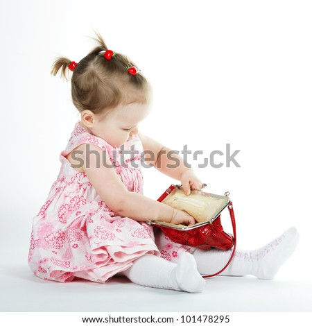 Girl Looking in Purse - stock photo