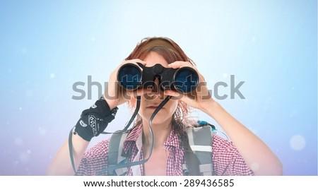 girl looking through binoculars over shiny background - stock photo