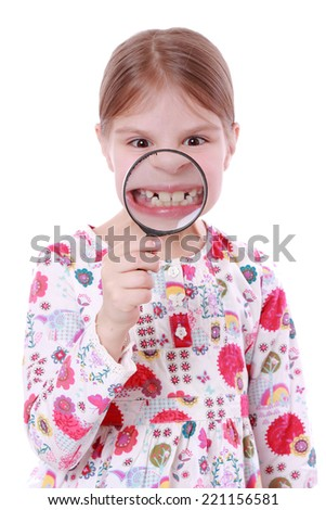 girl looking through magnifying glass isolated over white background