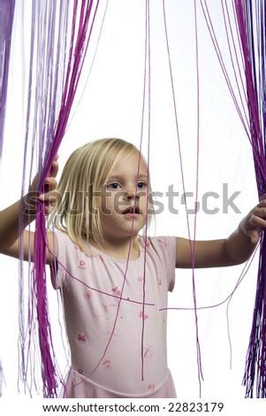Girl looking through strings - stock photo