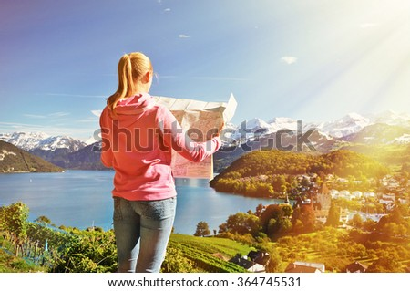 Girl looking to the map. Spiez, Switzerland - stock photo