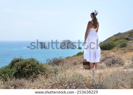 Girl looking to the sea near Aphrodite birthplace, Cyprus - stock photo