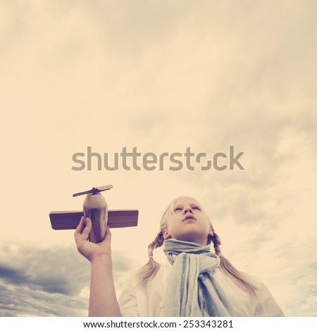 Girl looking to the sky - future and aspiration concept - stock photo