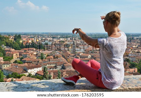 Girl looking to Verona town, Italy  - stock photo