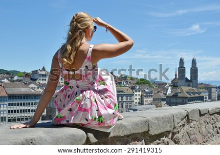 Girl looking to Zurich downtown - stock photo