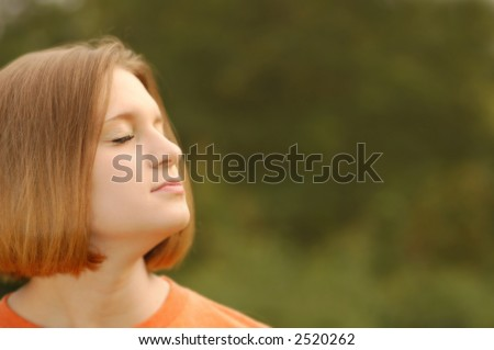 Girl looking toward heaven with ample copy space - stock photo