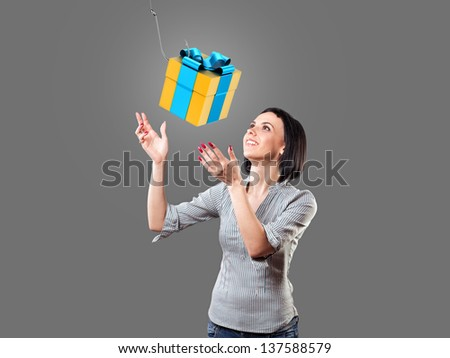Girl looks at a beautiful gift with a hook - stock photo