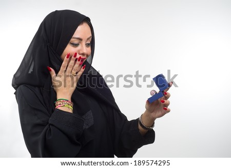Girl looks at box with ring,isolated on white background  - stock photo